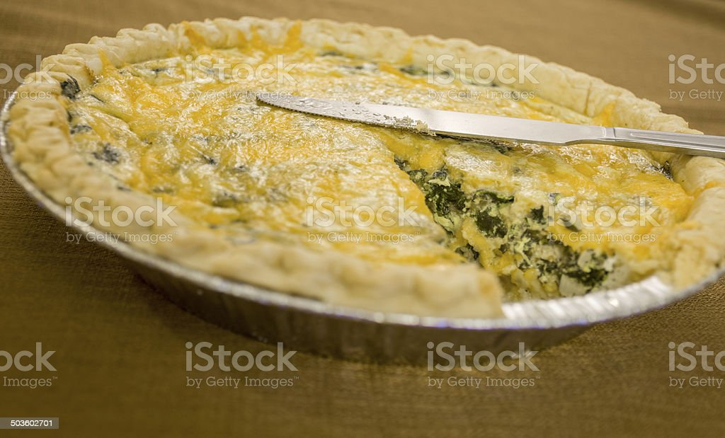 Quiche with Spinach and feta and cheddar cheese stock photo