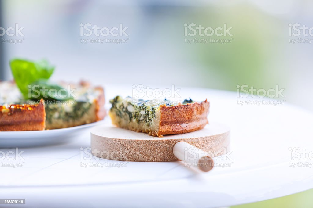 Quiche with spinach stock photo