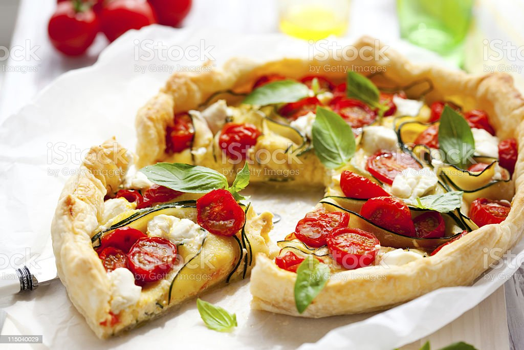 quiche with tomato and zucchini stock photo