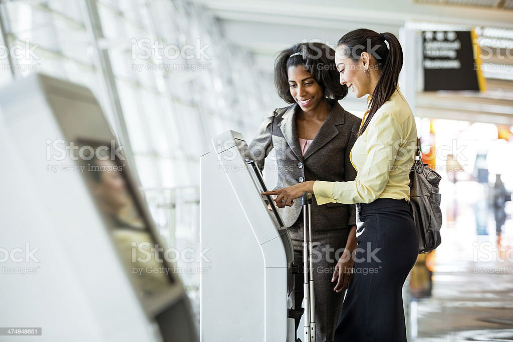 Quick Check-In at Airport for business women stock photo