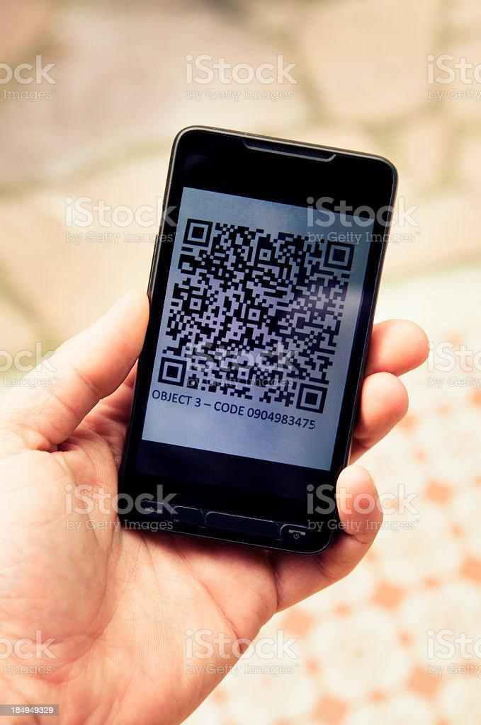Quick response code on smartphone stock photo