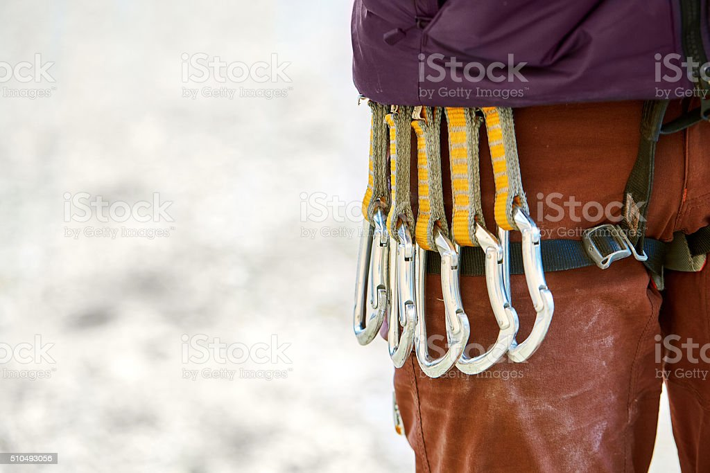 quick-draws on the  climber's harness stock photo