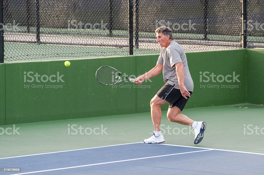 Quickly getting to the ball. stock photo