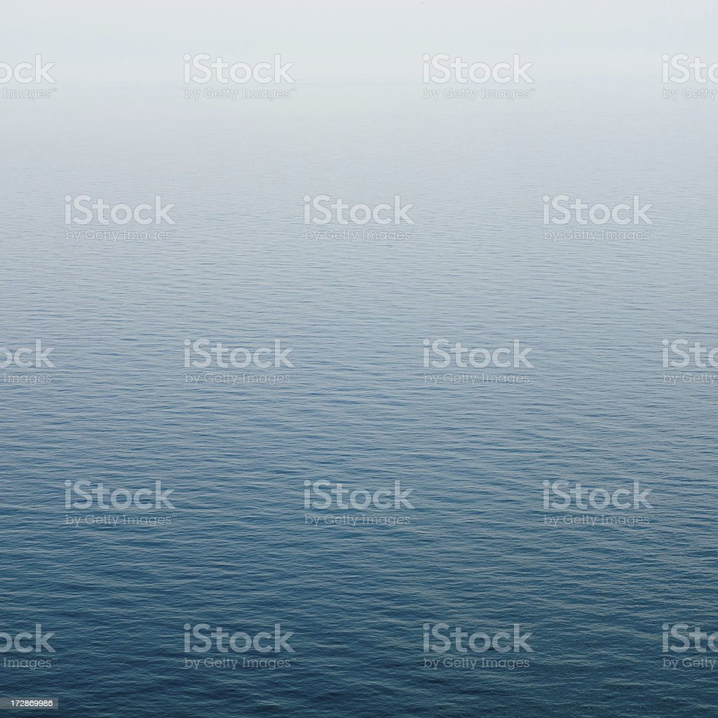 quiet aquatic smooth surface with waves stock photo