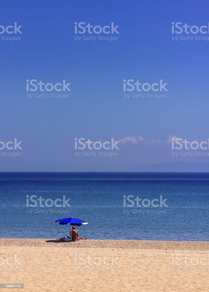 quiet beach sunbathe royalty-free stock photo
