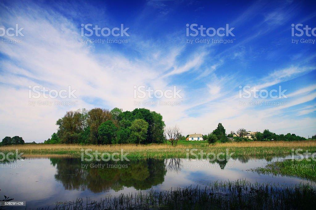 Quiet blue river near the village. stock photo