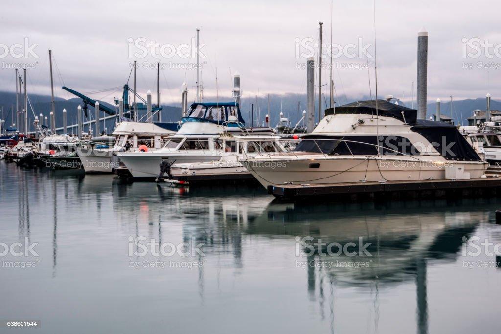 Quiet boat dock at dawn in Seward, Alaska. stock photo