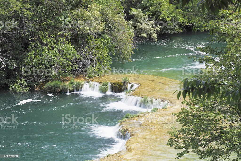 quiet cascade with streaming water rocks and green Croatia Krka royalty-free stock photo