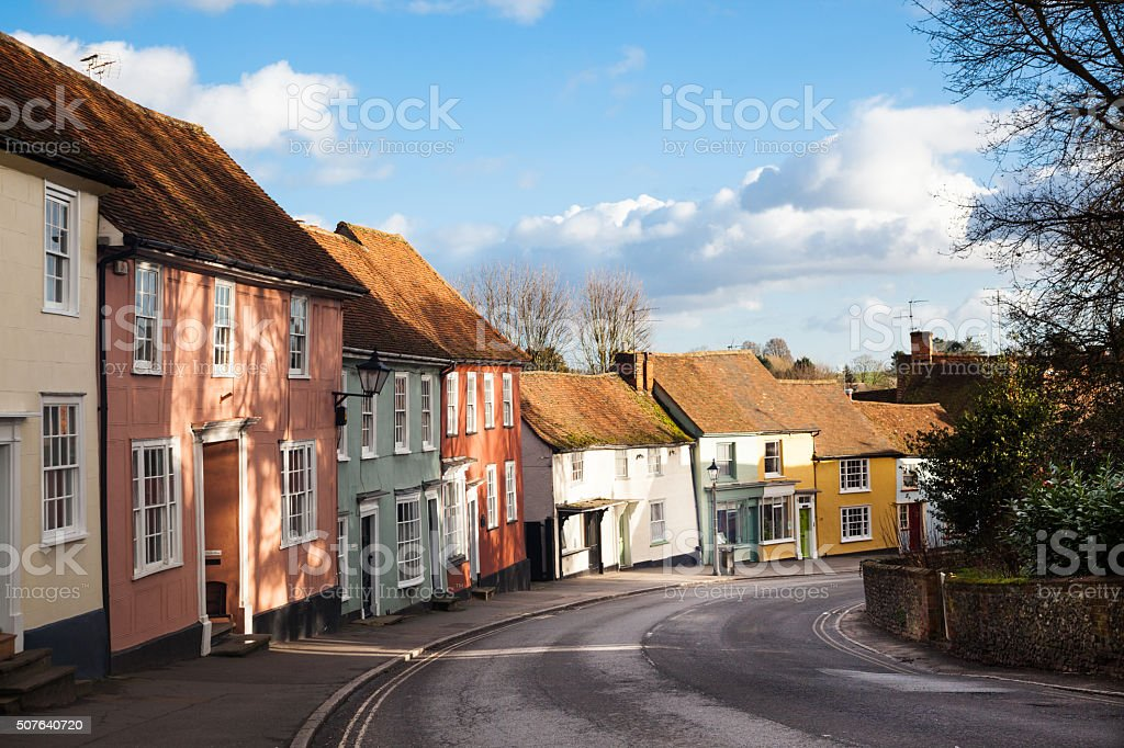quiet essex village street and houses in winter sun stock photo