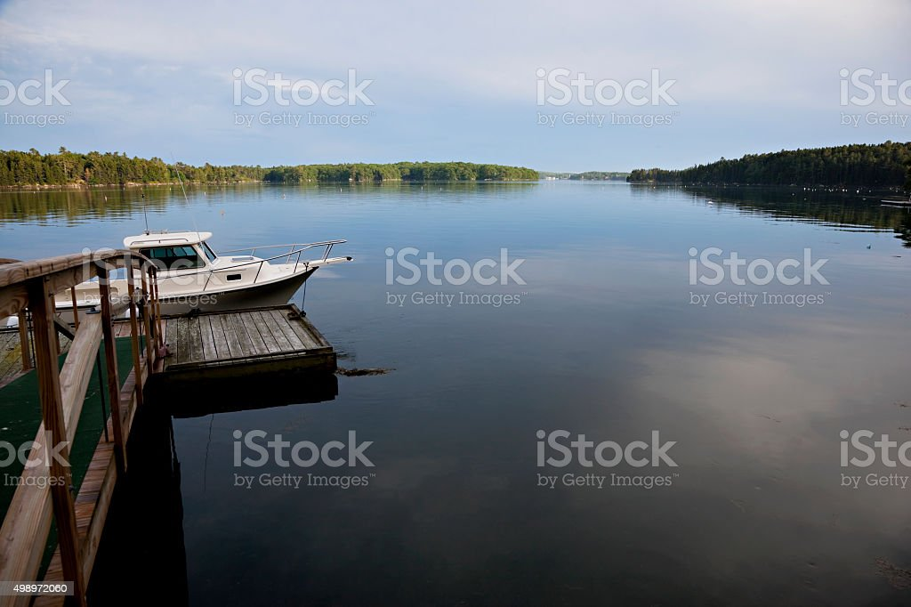Quiet evening at the dock on the river. stock photo
