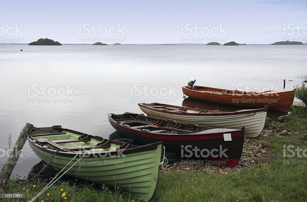 Quiet lake and rowboats royalty-free stock photo