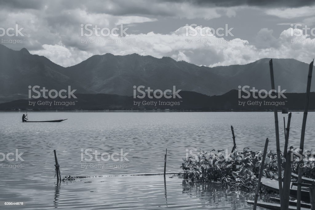 quiet lake mountain sky black and white tone. stock photo