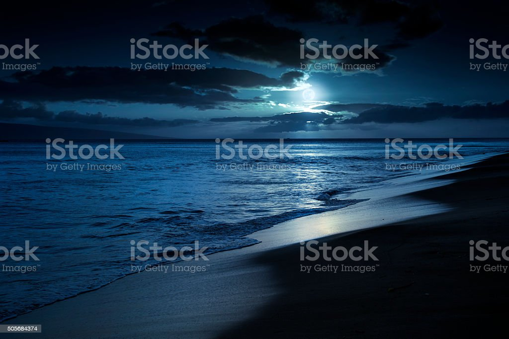 Quiet Moonlit Beach in Maui Hawaii stock photo