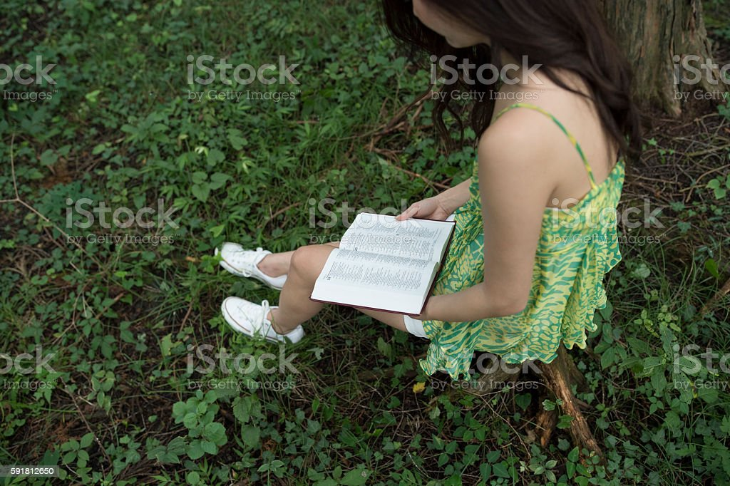 Quiet reading to the girls in the forest. stock photo