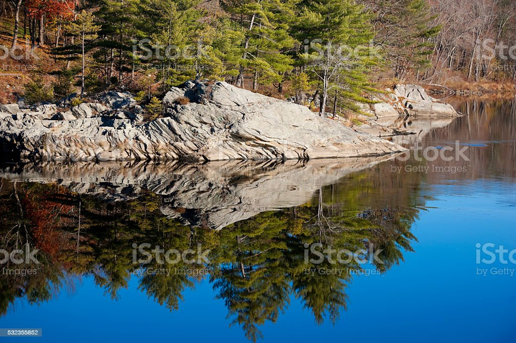 Quiet river with reflections in Maine, USA stock photo