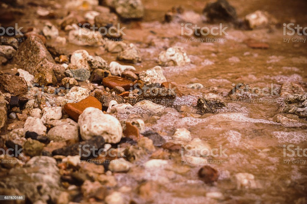Quiet sea surf on a pebble beach stock photo