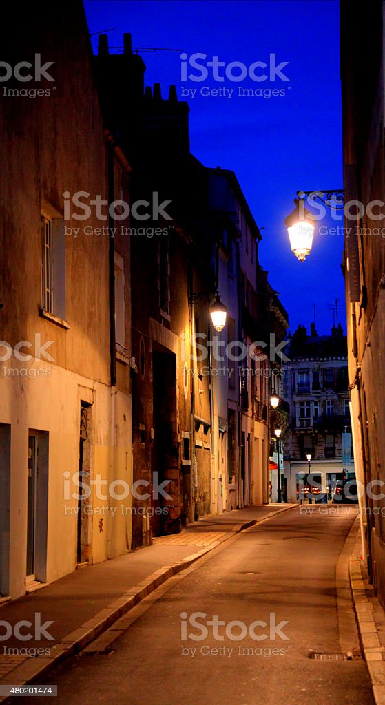 Quiet street in Orleans France at dusk stock photo