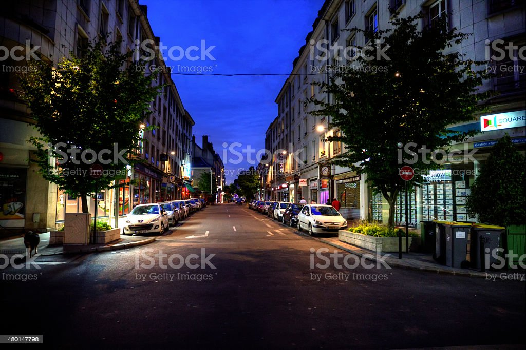 Quiet street scene in Orleans France at dusk stock photo