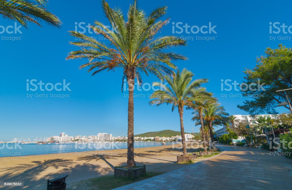 Quiet walk beside the beach in sunny Sant Antoni de Portmany, Ibiza, Spain. stock photo