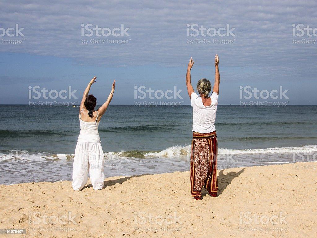 Quigong at the beach of Goa stock photo
