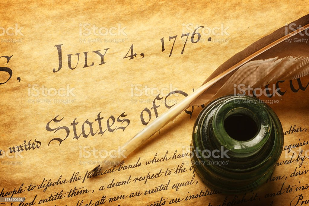 Quill and inkwell on top of Declaration of Independence stock photo