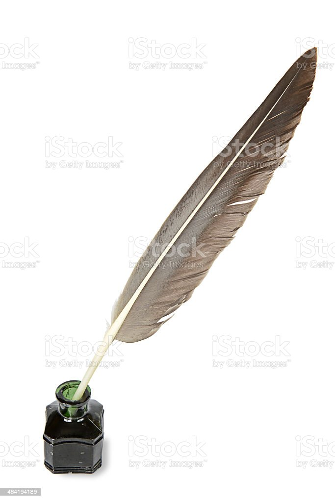 Quill in the inkwell stock photo