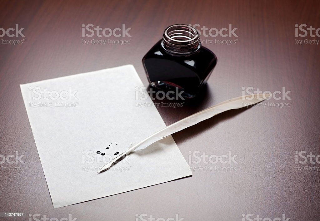 Quill, ink and paper royalty-free stock photo