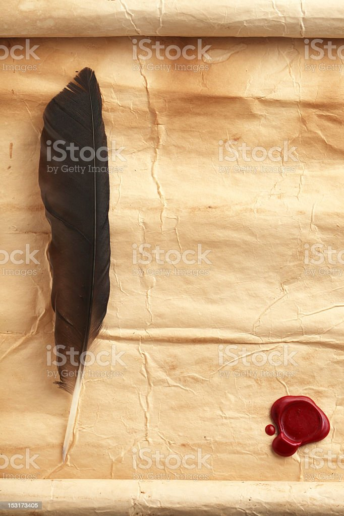 Quill on blank parchment paper with red wax seal stock photo
