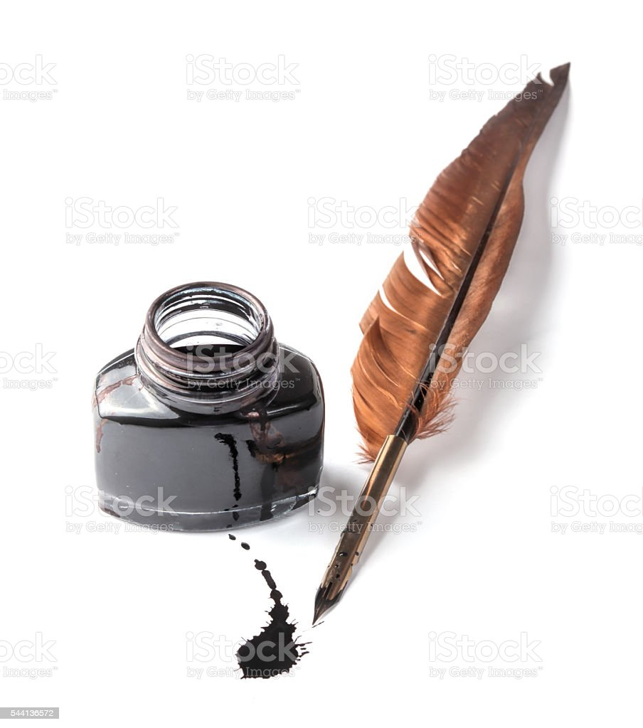 Quill pen and ink well on white background stock photo