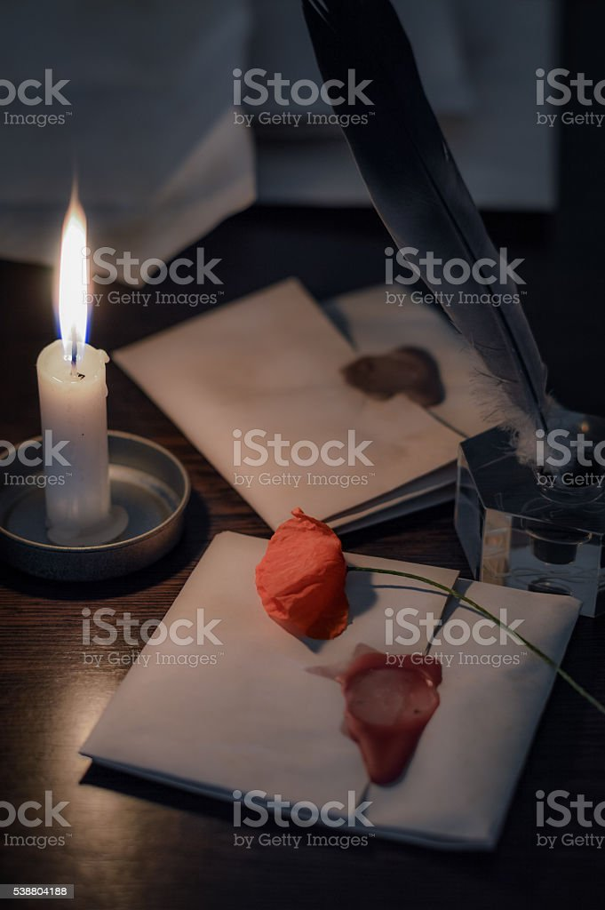 Quill pen and old letters stock photo
