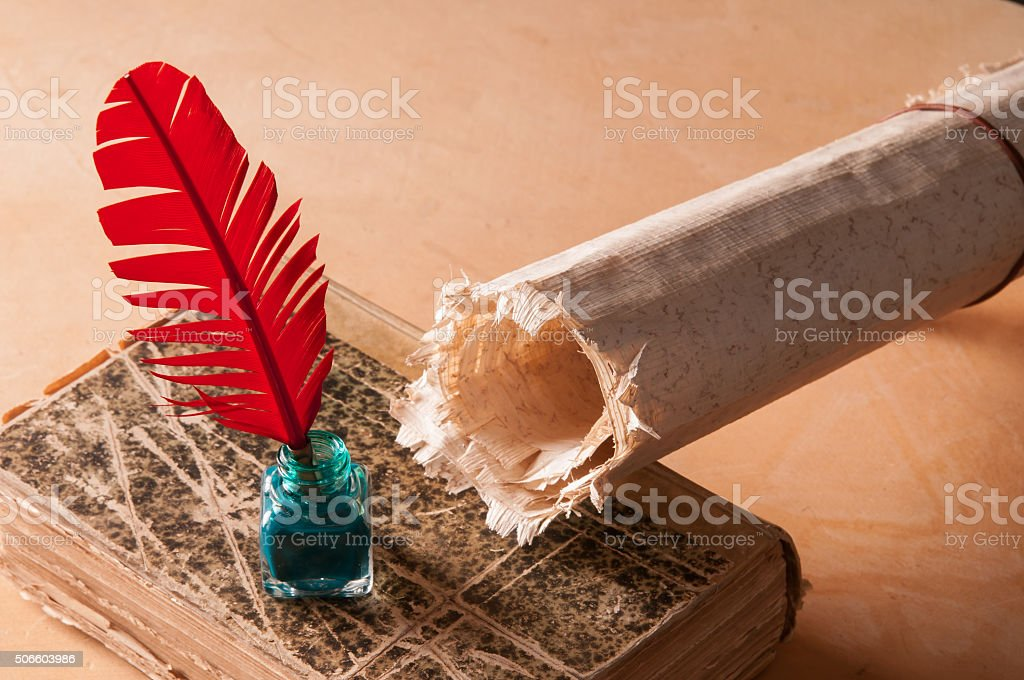 Quill pen and papyrus sheet stock photo