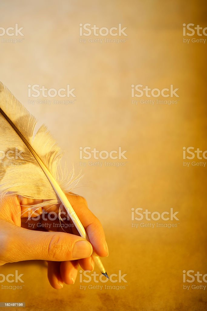 Quill pen in a hand royalty-free stock photo