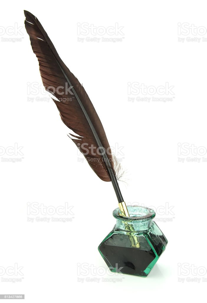 Quill pen in glass ink bottle stock photo