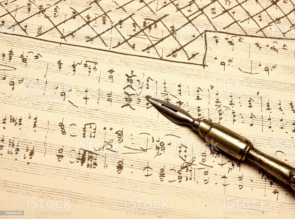 Quill pen on sheet music paper royalty-free stock photo