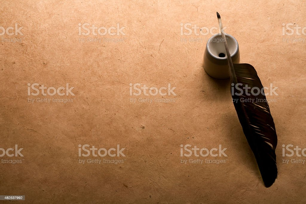 quill pen on vintage paper stock photo