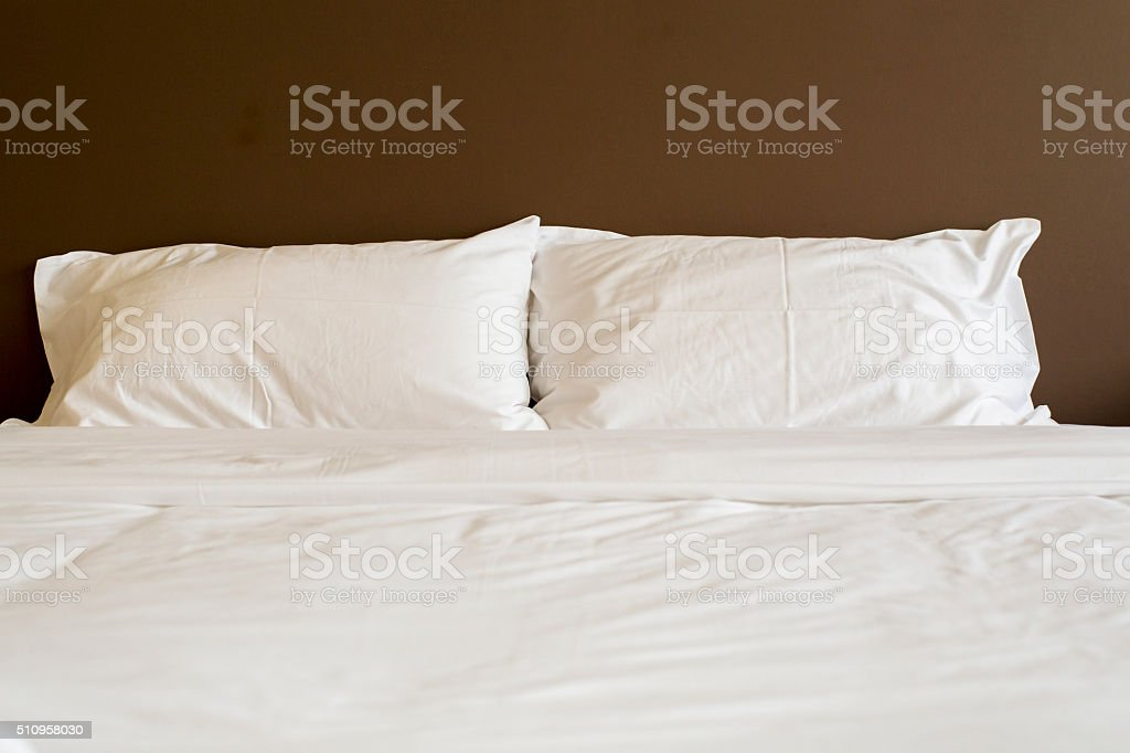 quilt and pillow in bedroom stock photo
