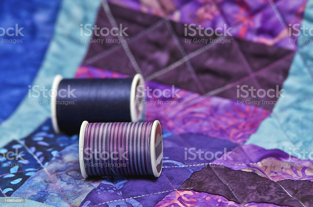 Quilt and quilting thread stock photo