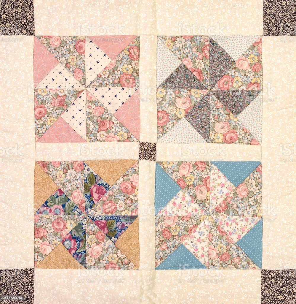 Quilt Block Pinwheel Pattern, Traditional Handmade Sewing and Needlecraft stock photo