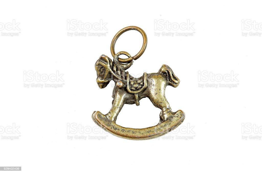 Quilt tool : Rocking horse keyring isolated on white background stock photo
