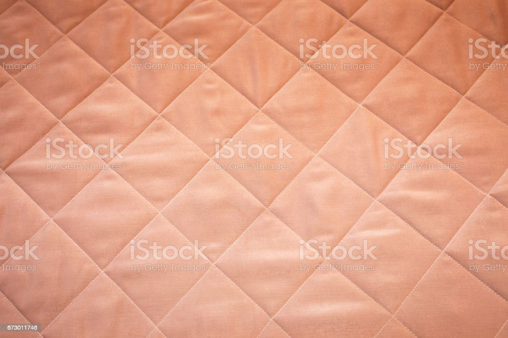 quilted blanket soft pink background stock photo