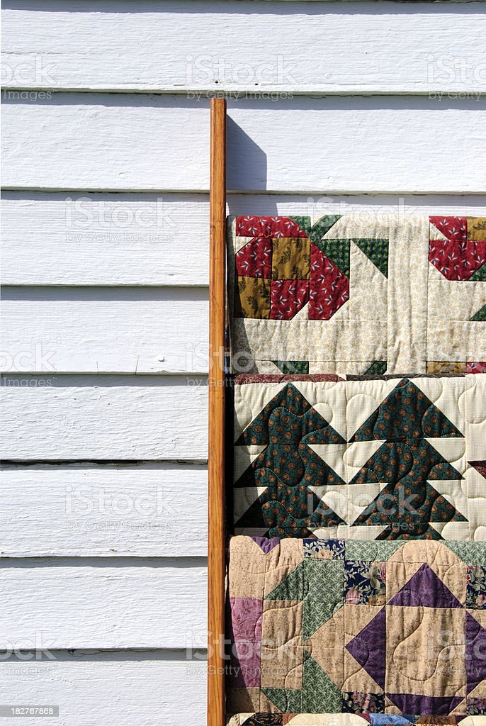 Quilts on a quilt rack stock photo