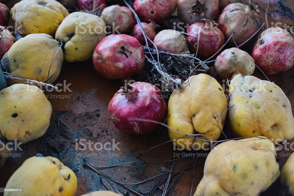 Quince and pomegranates stock photo