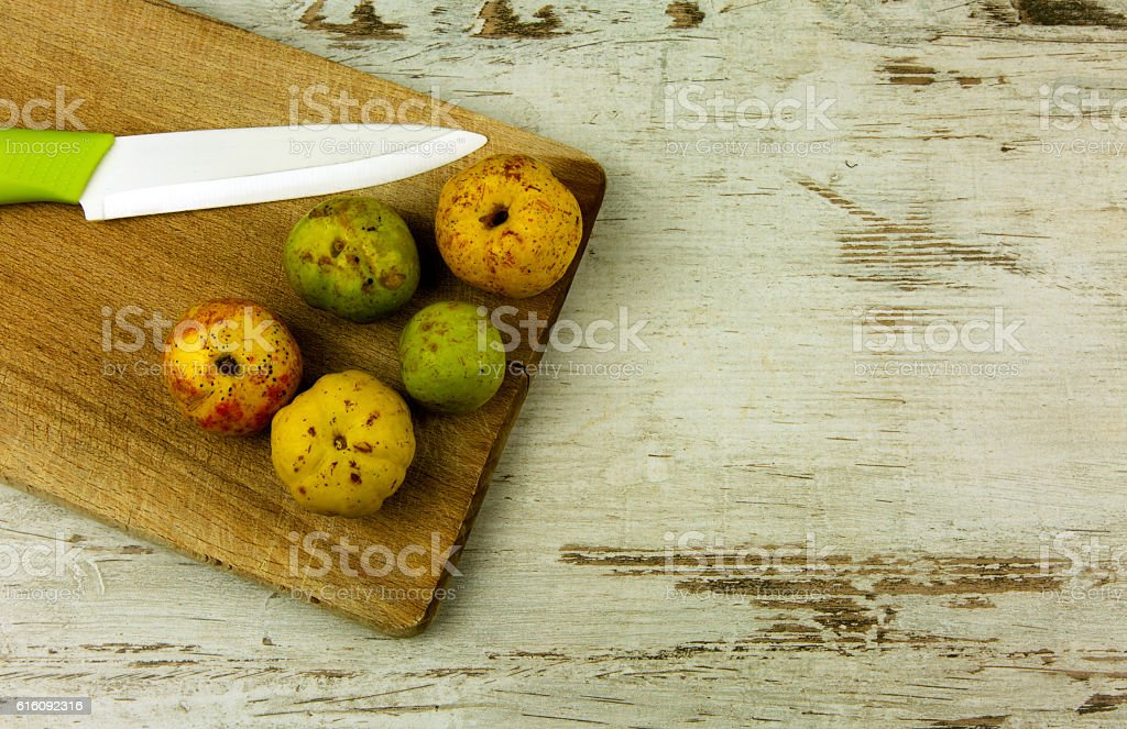 Quince fruits on wooden background stock photo