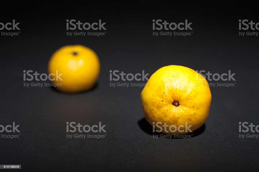 Quince on a black background stock photo