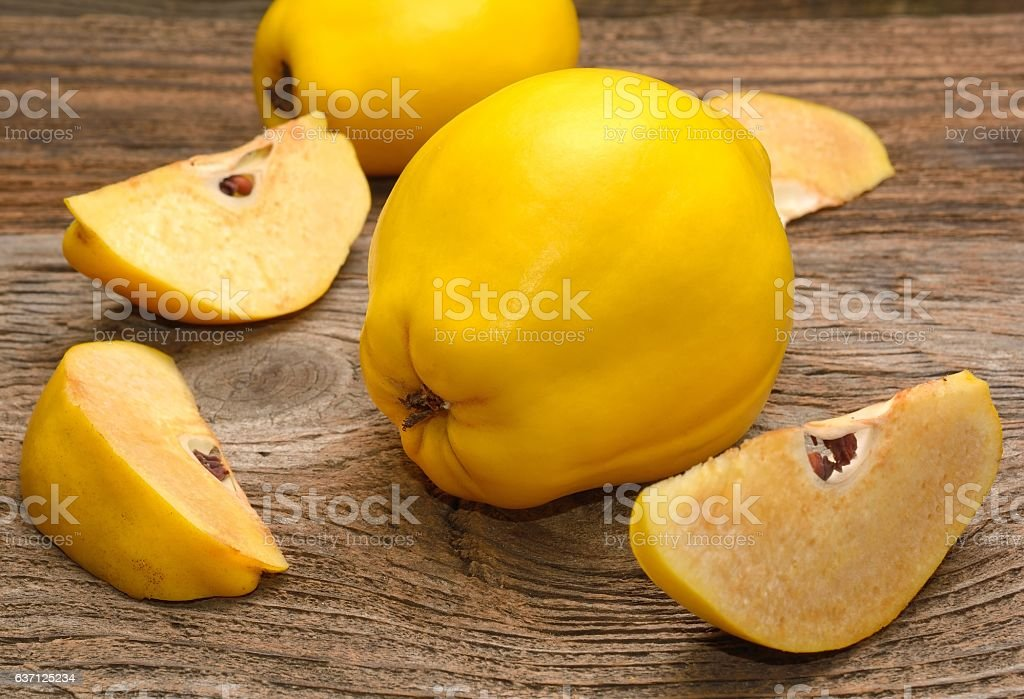 Quince on wooden table stock photo