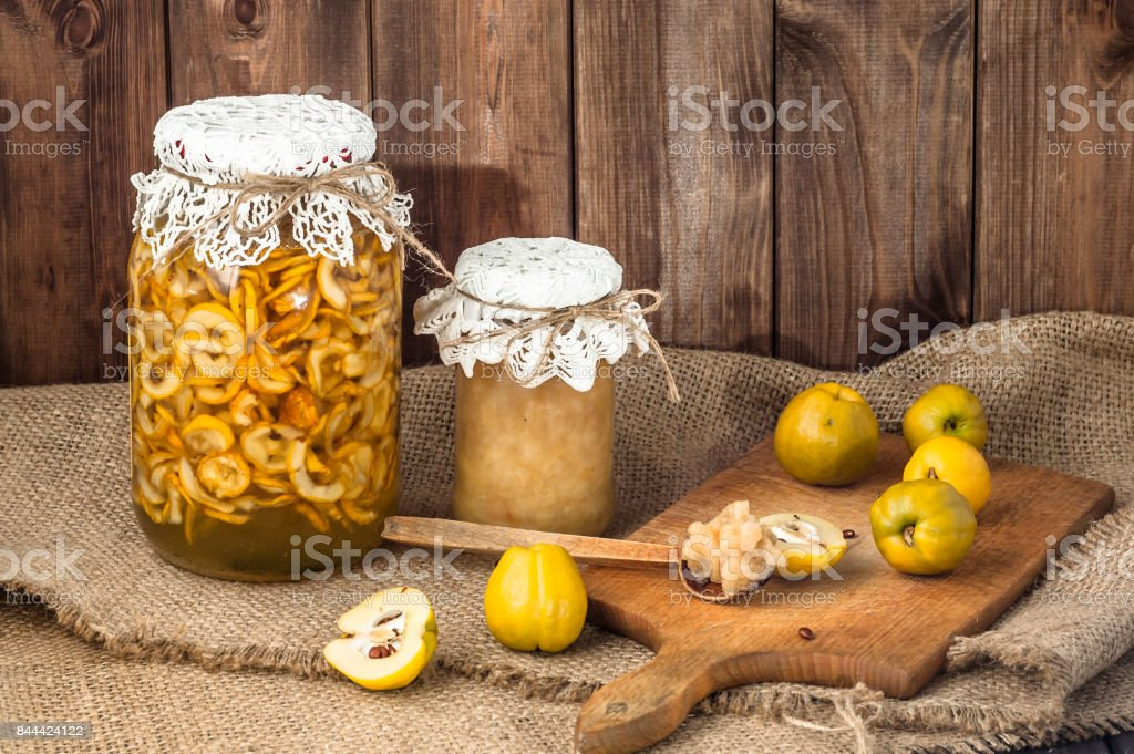 Quince preserves in a wooden pantry. stock photo