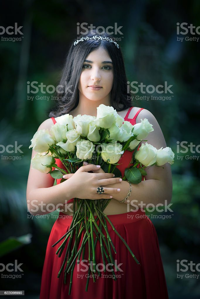 Quinceanera with flowers stock photo