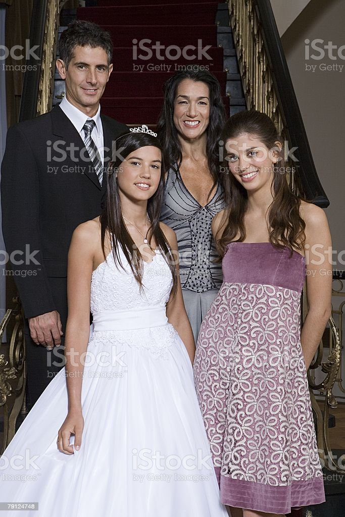 Quinceanera with her family stock photo
