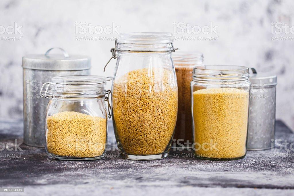 Quinoa, bulgur and couscous cereals. stock photo