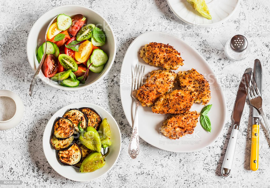 Quinoa crusted chicken, vegetable salad, grill eggplant and pepper stock photo